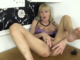 Blonde Granny In Black Stockings, Elaine Is Masturbating While At Work, Because It Feels Good blonde granny in black stockings elaine is masturbating while at work