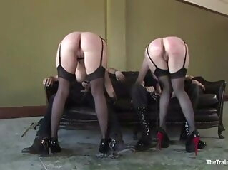 Two female slaves serving their masters bdsm spanking